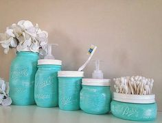 Bathroom Decorative's Paint old cans and the like in a cute color to hold several bathroom utensils