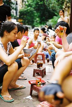 Where dining is best in a social setting, a typical street scene in Vietnam.