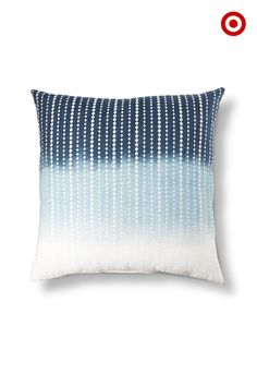 Blue's big for spring. Bring a range of this calming hue into your decor with an embroidered ombre pillow.