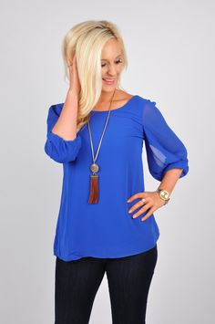 Our Small Talk Top will get EVERYONE talking! This quarter sleeve hi-low woven top features detailed sleeves. The crisscross design in the back, adds a chic look to your whole outfit! Add a long necklace to help dress it up, or add jeans for a more casual look. This top is made out of 100% Polyester. Hand-wash cold. Hang or flat dry.
