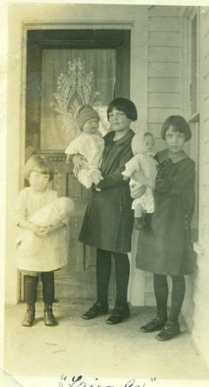 1920s Friends Girls Holding Dolls on Front Porch ~ I like how they're holding they're dolls, especially the little one.