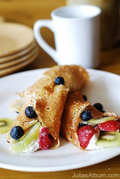 Breakfast and dessert crepes with ricotta cheese, berries, and kiwi
