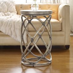 Features:  -Material: Gmelina hardwoods with rattan and robus leather.  -Croc embossed robus leather.  -Melange collection.  Shape: -Round.  Design: -Table.  Style: -Contemporary.  Top Finish: -Gold.
