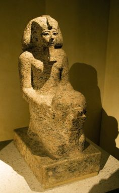 Statue of the 18th Dynasty female Pharaoh Hatshepsut (r. ca. 1478-1458 BCE), kneeling and holding a cultic vessel.