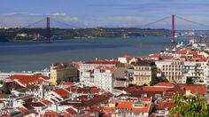 Lisbon, Portugal. The Pont 25 de Abril bridge is almost identical to San Francisco's Golden Gate Bridge.