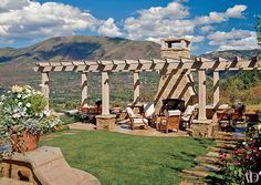 At this Aspen, Colorado, home by interior designer David Easton and architect Eric J. Smith, the pergola-covered seating area has a working fireplace.