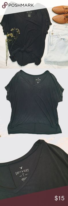 AE Green Soft And Sexy Tee Relaxed and soft, this Tee from American Eagle is the perfect basic.  It features a stretchy and lightly distressed vintage looking material, a slouchy and oversized fit, and an open v neck with short sleeves.  48x48 inches this top is slightly longer in the back than in the front.  Perfectly pairs with your favorite vintage denim. American Eagle Outfitters Tops Tees - Short Sleeve