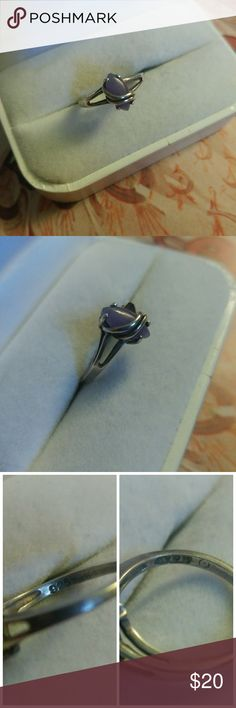 Avon sterling silver purple jade ring Avon sterling silver purple jade ring  -This ring features a purple jade center stone with sterling silver lined accent in sterling silver setting  -This ring is marked 925 and Avon with maker's hallmark  -This is a used ring and does show some signs of wear such as surface scratches and tarnish   -boho, fashionista, hippie, vintage, beautiful Jewelry Rings