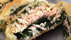 An excellent blend of salmon, pesto, spinach, and puff pastry.  It tastes great and only takes a few minutes to put it all together!