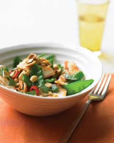 Spicy Chicken Stir-Fry with Peanuts - Don't sacrifice bold flavors for speed. This stir-fry of chicken, snow peas, and peanuts is ready in just minutes and is redolent with the flavors of lime and chiles.