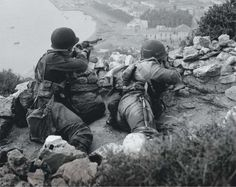 A pair of US Army Rangers during World War II, location unclear. The soldier on the left carries a customized M1903, fitted with the M1 grenade launcher attachment.