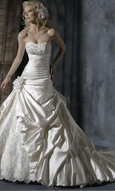 Yes, I am already married....but this is so pretty and I love wedding dresses!