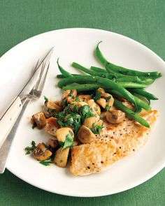 Ready in half an hour: tender chicken cutlets, served with green beans, herbed mushrooms, and a buttery sauce.