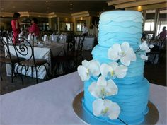 Blue beach themed wedding cake with sugar orchid branch detail