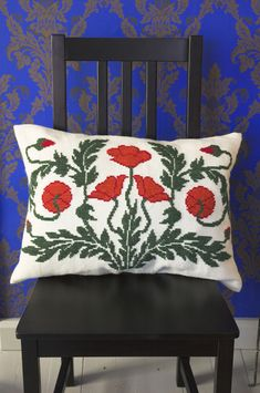 "Pillow ""Poppy"" by the Finnish arts & crafts shop Taito Pirkanmaa. Modified of a traditional pattern. Wool fabric and cross-stitches."