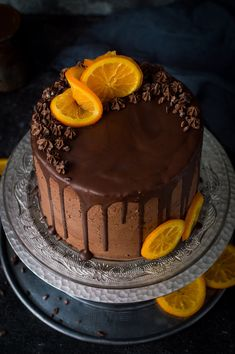 Angled photo of vegan orange and almond cake with chocolate orange vegan buttercream, chocolate drip and candied oranges on a glass plate and silver cake stand. Baking Recipes, Cake Recipes, Dessert Recipes, Chocolate Buttercream, Vegan Buttercream, Orange Buttercream, Buttercream Cake, Orange And Almond Cake, Fall Cakes