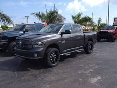 "Grey Dodge Ram 1500 with 4"" lift kit."