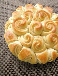 Douse them with butter and then roll and squish them together to create this yummy happy bread. It's perfect for a large family dinner; perhaps even in place of rolls at your annual Thanksgiving or Christmas dinner.