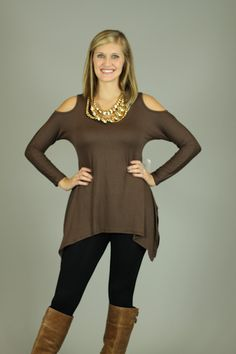 GREAT basic alertttt!!!! You need this top in EVERY color!! The exposed shoulders are super trendy, and the fabric is soooo soft!! The jagged hemline gives it that edgy look:) Add a scarf to this top or your favorite necklace. Pair it with jeans and boots for the perfect fall look.  Fits true to size. Kalan is wearing the small.