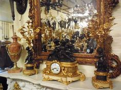 A  Rococo Style Gilt and Patinated Bronze Clock  Garniture. c. 1880 France http://www.degoedeoudetijd.com € 3.500,00