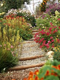 Make a path through the garden. Paths offer visual relief from crowded plantings. More important, they make the garden more welcoming and easier to maintain. Consider who will be walking through the garden and in what kind of shoes. This will help you decide whether to go with a soft surface such as gravel or wood chips, or a firm surface such as concrete. A grass path is an easy alternative where foot traffic is low, but it will require regular mowing.