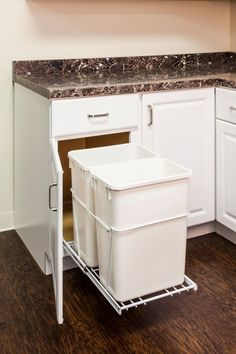 """35-Quart Double Pullout Waste Container System- 14 1/2"""" x 22"""" - Full Extension Ball Bearing Slides. - Heavy Duty White Wire Construction. - 35qt black polymer trash cans sold separately. - Designed for use with 13 gallon tall kitchen trash bags. - Mounts to Floor of Cabinet. Door Mountable (kit sold separately). Mounting Hardware and Instructions Included. - For standard 18"""" cabinets. (Item # CAN-EBMDW-R)"""