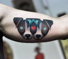 Two jack russels on the left inner arm.