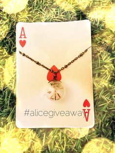 We are #givingaway our popular Alice In Wonderland Dandelion in a bottle necklace.  To enter: 1) follow us at facebook Alice In Wonderland Tea Party 2) repost 3) tag us and 3 friends 4) get as many likes as possible.  Open to worldwide, end 31/5/15.  We'll announce the winner here.