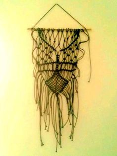 Unique Handmade Macrame Wall hanging With Black Cord. $40,00, via Etsy.