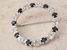 Circle Pin Brooch Black Clear Prong Set Silver Tone Vintage V0668 by cutterstone on Etsy