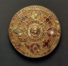The Kingston Brooch, 7th Century AD. Anglo-Saxon - gold, inlaid with blue glass, white shell and cut garnets. This is the largest and finest brooch of its kind to be found.