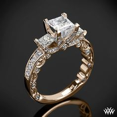 This beautiful 3 Stone Engagement Ring is from the Verragio Paradiso Collection. It features a Lumino Set for both the center and side diamonds and holds 1.00ctw of both Round Brilliant & Princess Diamond Melee