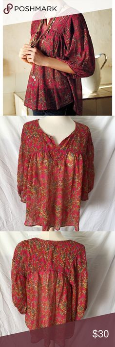Anthropologie Beautiful Top! Anthropologie Lil brand Top! Pink paisley print! Very boho style! Flowy style! 3/4 sleeves! Size Large! Great condition! 100% Viscose. 28.5 inches long. Bust measuring across 20 inches! Anthropologie Tops Blouses
