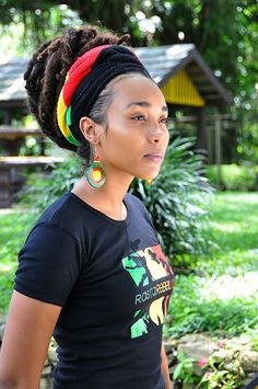 livelaughlovelocs:  Mbele TV Mbele Tv's Host, Gicelle Ann Magloire on location Wardrobe: Rasta Rebel Lion Baby Tee  Earrings by Ila Addis  Photo Credit: Mark Ali  — with Gicelle Ann Magloire, Rasta Rebel Lion, Ila Addis, D'Caribbean Culture Shack, Safiya Fyah Dawta Olugbala and Christian Boucaud.