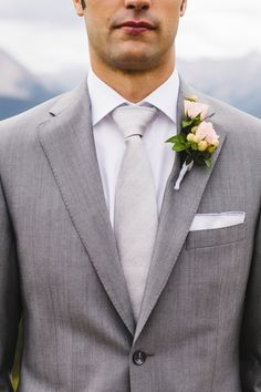 Pink Rose Boutonniere | James Christianson Photographer | theknot.com