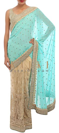 Buy Online from the link below. We ship worldwide (Free Shipping over US$100) http://www.kalkifashion.com/half-saree-in-beige-and-mint-embellished-in-thread-embroidery-and-pearl-only-on-kalki.html
