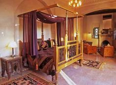 Exotic Moroccan Bedroom Decorating, Light and Deep Purple Colors  Warm yellow, orange and red color shades are combined with blue and green tones, blended with light and deep purple colors, inspired by dark nights and picturesque landscapes under the hot African sun, creating an ideal interior design color schemes for relaxing and welcoming Moroccan bedroom decorating.