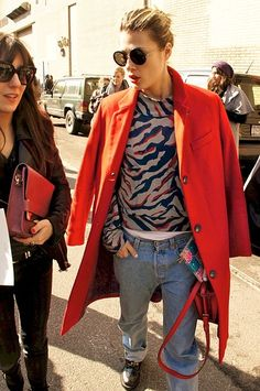 A printed sweater, red coat and worn jeans = effortlessly cool! #winter, #redcoat, #wornjeans, #streetstyle