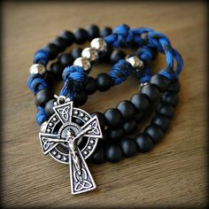 Super strong Celtic style paracord rosary in lots of colors.  I love the black and blue.