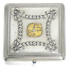 A FABERGÉ IMPERIAL PRESENTATION SILVER CIGARETTE CASE WITH JEWELLED GOLD MOUNT, MOSCOW, 1895    square, the lid and base applied with festoons of chased ribbon-tied laurel within engraved key fret borders, the lid centred with a gold Imperial eagle set with a diamond, cabochon sapphire thumbpiece, gilt interior, struck K.Fabergé in Cyrillic beneath the Imperial Warrant, 84 standard  width: 9cm, 3 1/2 in.