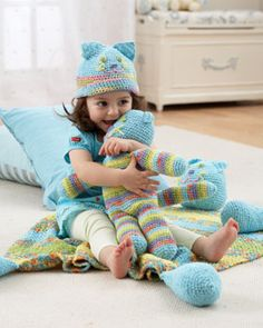Huggable toy cat, matching hat, and a blanket that hugs back. All crocheted using Bernat Baby Stretch.