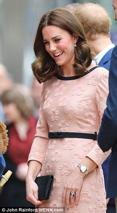 Although she's been suffering with morning sickness, she looked just peachy in a designer pink dress for the occasion