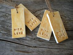"""A set of 4 Christmas gift tags in gold stamped with the words """"with love"""""""