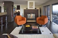 Would you like to sit and spin in my so cool orange chairs?     Grandin Road Color Crush on Burnt Orange