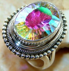 | Incredible Mystic Quartz Studed In Sterling Silver Ring |
