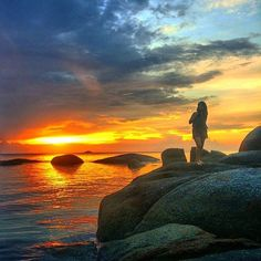 Stamp #483 - Indonesia: Sunsets of Belitung Island! Tanjung Tinggi Beach only 30 minute from city by car/motorcycle you can find a beautiful beach with many big granite stones white sand clear water & the most unbelievable sunset. Dont forget to get your camera to capture the moment so you can relive this memory in the future! Thanks @beautifulbelitung for your awesome #stamp. For more awesome travel tips and adventures download the Stamp Travel App Today. The link is in our bio!