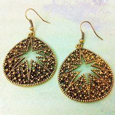 Antique Gold Starry Teardrop Earrings., via Etsy.