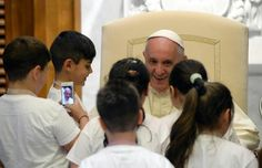 Pope Francesco with children.