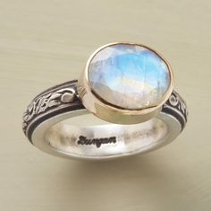 Light Of The Moonstone Ring USD: 320.00 A gem-cut moonstone mesmerizes in a 14kt goldfilled setting atop a scrolled band of oxidized sterling silver. Exclusive.