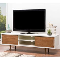 Twin tones intertwine intensely in our Gemini Wood Contemporary TV Stand. Boasting a compellingly contrasting white-and-walnut faux wood-grain paper veneer, this TV stand brings sensational styling to